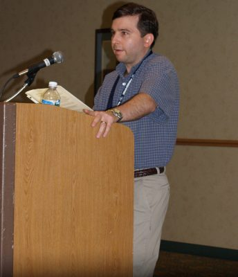 Speaker Karl Robb at Podium Young Onset Parkinson's Conference Georgia