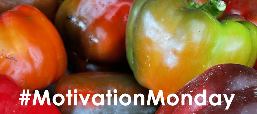 Picture of red and green peppers by Karl Robb with text Motivation Monday on top in white font