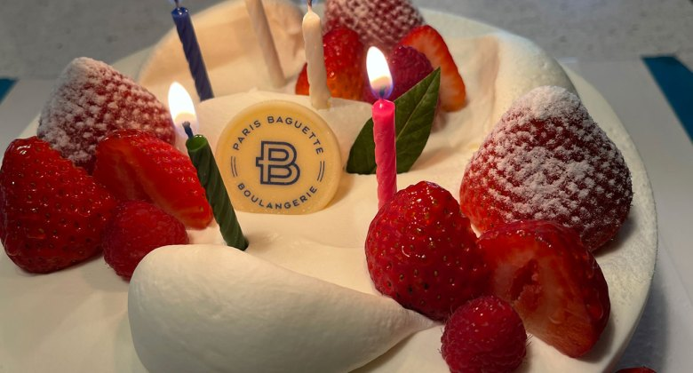 Birthday cake with candles and strawberries